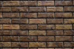 Brun tappningtegelstenvägg Arkivbild