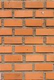 Brun tegelstenvägg Arkivfoto