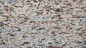 Brun tegelstenvägg för klassiker Arkivfoton