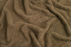 brun torkdukefrottéhandduk Arkivbild