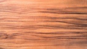 Brun wood yttersidatexturbakgrund med den naturliga kurvmodellen Arkivfoto