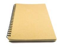 Bruna anteckningsböcker på vit bakgrund Arkivbild