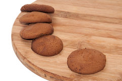 Bruna kakor på ditt kökträbräde Arkivbild