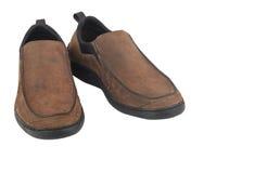 Bruna lädermanskor som isoleras på vit bakgrund Arkivfoto