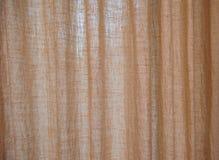 Bruna säckvävgardiner för textur Arkivbilder
