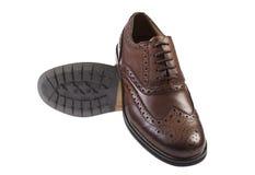 bruna skor Arkivfoto