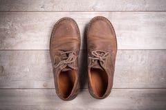 bruna skor för män s Arkivbild