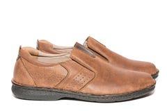 Bruna skor för man` s Arkivfoto