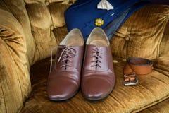 Bruna skor för wholecuts för lädermedaljongtå Fotografering för Bildbyråer