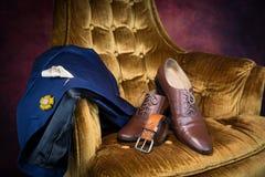 Bruna skor för wholecuts för lädermedaljongtå Arkivfoton