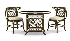 bruna stolar isolerade rottingtabellwhite Fotografering för Bildbyråer