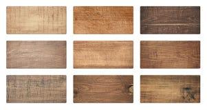 Bruna träskärbrädor, skylten, plankor isoleras på vit bakgrund royaltyfria foton