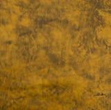 Brunaktig orange syra tvättad brun lädertrycktextur Arkivfoton