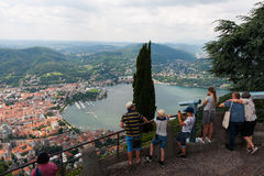 BRUNATE, ITALY - MAY 2016:Tourists on observation deck overwatch Como Lake stock photography