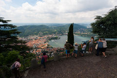 BRUNATE, ITALY - MAY 2016:Tourists on observation deck overwatch Como Lake Stock Photos