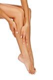 Brunbrända ben för kvinna Arkivfoton