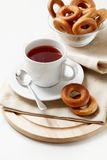 Brunch. Photo of brunch of cup of tea with sweet bread-rings Royalty Free Stock Images
