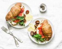 Brunch or breakfast table - croissants with cream cheese and smoked salmon, and cherry tomatoes. Delicious balanced breakfast, br stock photos