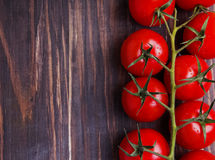Brunch of cherry tomatoes. Dark toned photo Royalty Free Stock Photography