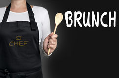 Brunch cook holding wooden spoon background.  Royalty Free Stock Image