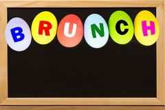 BRUNCH on Eggs colorful on chalkboard with copy space. stock photos