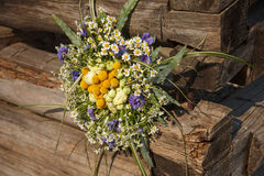 Brunch of flowers. Colorful posy near wood. Brunch made of dasies Royalty Free Stock Photos