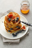 Brunch pancakes with berry and honey. Food closeup Stock Image