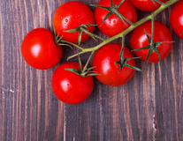 Brunch of red cherry tomatoes Royalty Free Stock Images