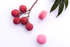 Brunch of ripe lychee and lychee macaroons with leaf isolate on Royalty Free Stock Images