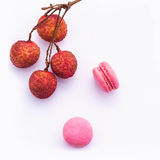 Brunch of ripe lychee and lychee macaroons with leaf isolate on Stock Photo
