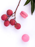 Brunch of ripe lychee and lychee macaroons with leaf isolate on Stock Photography