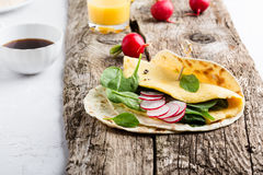 Brunch table. Homemade omelette spinach tacos. On rustic wooden table, Mexican food Royalty Free Stock Photo