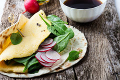 Brunch table. Homemade omelette spinach tacos. On rustic wooden table, Mexican food Stock Image