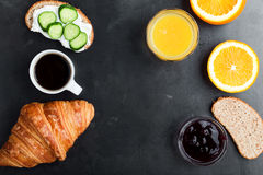 Brunch table with toasts, croissant, orange juice and coffee, to. Toasts, croissant, orange juice and coffee on rustic blue table, brunch table viewed from above Royalty Free Stock Image
