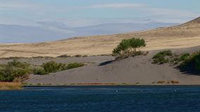 Bruneau sand dunes idaho 39 big dune distant. Bruneau Sand Dunes Idaho 39 Dunes Lake Across stock footage