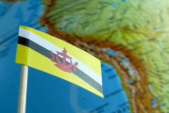 Brunei flag with a globe map as a background Royalty Free Stock Image