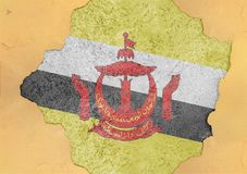 Brunei flaggaabstrakt begrepp i betong för agg för fasadstruktur stor skadad royaltyfri foto