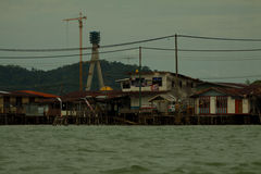 Brunei's water village called Kampong Ayer with highway construction area in Bandar Seri Begawan Stock Images