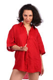 Brunet curly-headed girl in red male shirt beckon Stock Photo