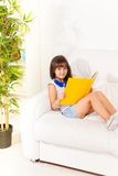 Brunet girl with book Royalty Free Stock Images