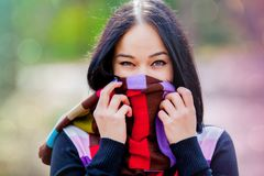 Brunet girl with colorful scarf. In the park Stock Photo