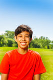 Brunet happy boy in red T-shirt portrait Royalty Free Stock Photography