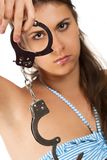 Brunet looking through handcuffs Stock Image