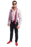 Brunet male model with purple shirt and two open neckties Stock Images