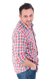 Brunet male wearing checkered shirt and jeans Royalty Free Stock Photos