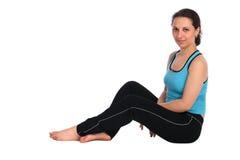 Brunet sport girl sits on floor posing stock images