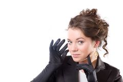 Brunet woman in black gloves Royalty Free Stock Image