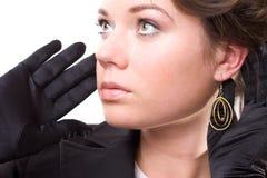 Brunet woman in black gloves Stock Photos