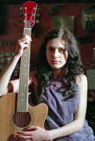 Brunet woman with guitar. Brunet woman play on guitar Royalty Free Stock Photography