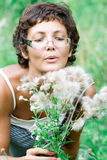 Brunet woman in a meadow Stock Photography
